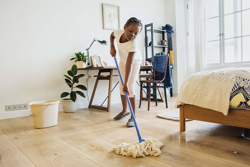 black child cleaning