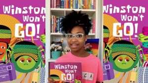 image of a girl wearing glasses holding up a purple book with the title winston won't go