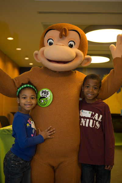 The kids with Curious George at PBS Headquarters :: SocaMom.com