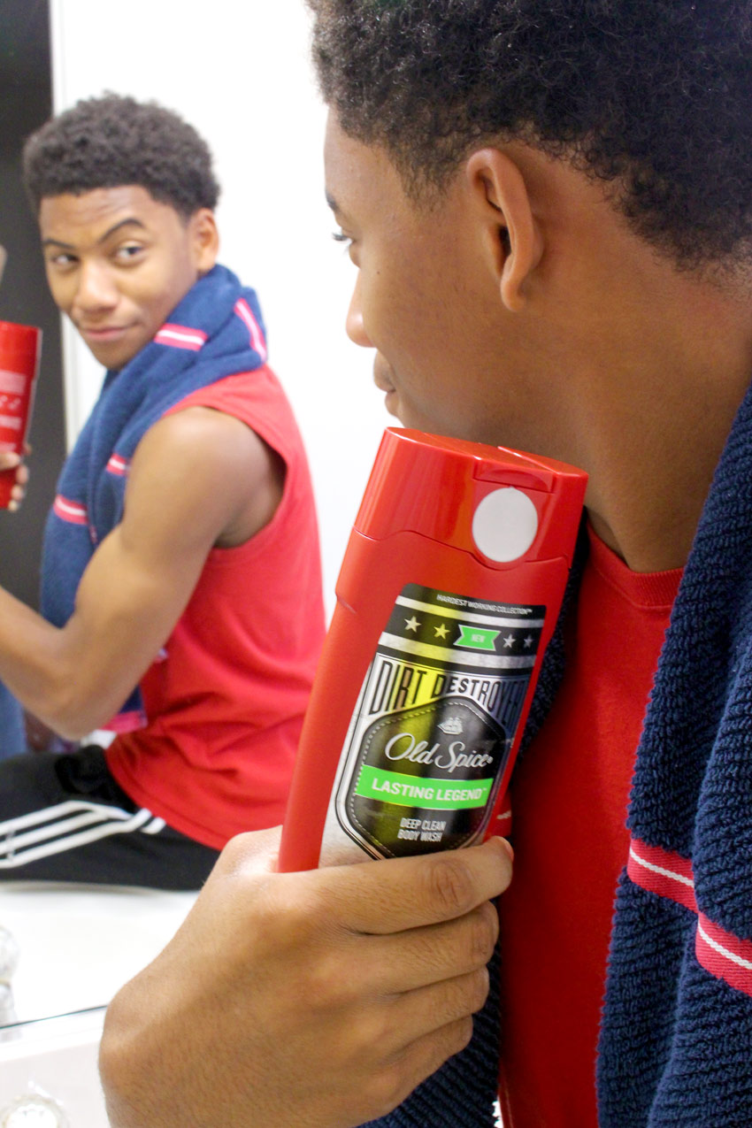 Teen in mirror with Old Spice Body Wash