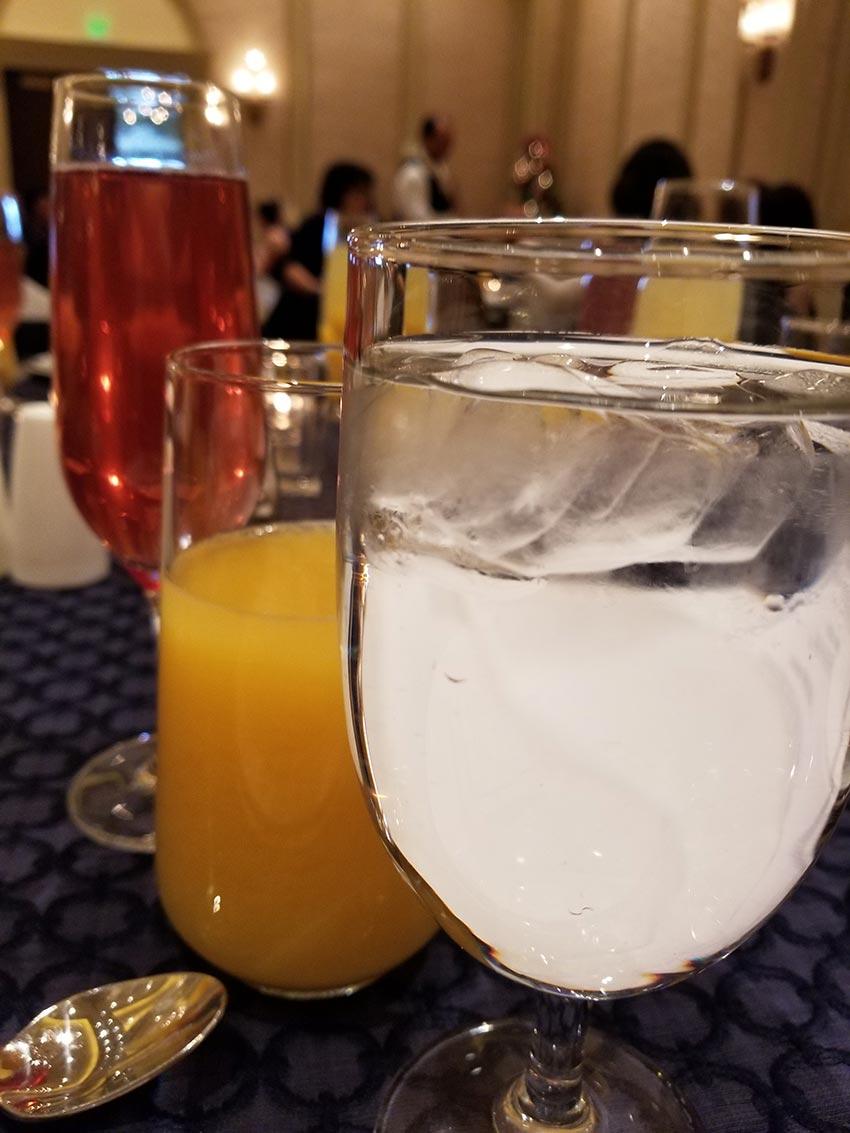 pomegranate mimosa, orange juice, tea, traditional mimosa