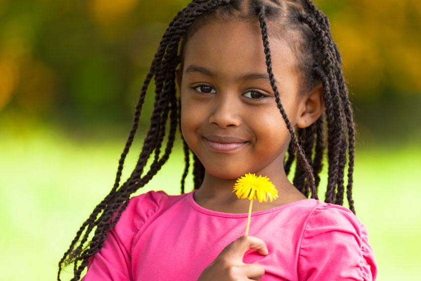 Caribbean Parenting Amongst the Weeds - Girl with dandelion flower