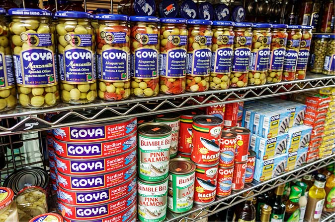 cans of coya products on a grocery store shelf